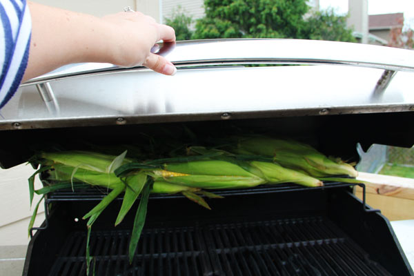 corn on the grill with shucks